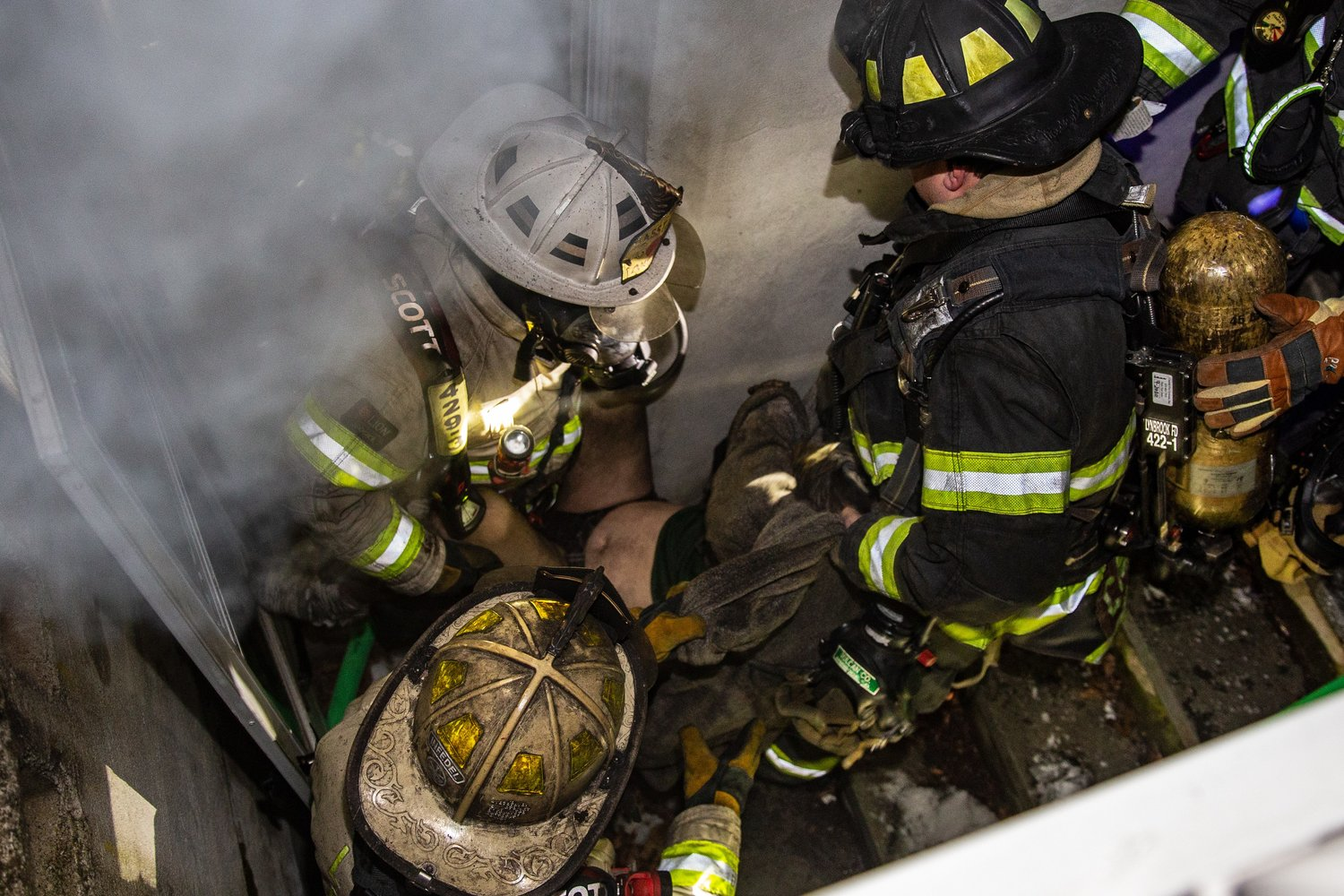 Lynbrook firefighters carried an unconscious man up a staircase from the burning basement of a home on Shipherd Avenue on Feb. 21.