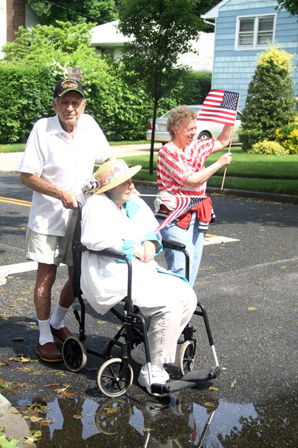 Eddie Rosenblum was a regular in West Hempstead's annual Memorial Day parade. Above, Eddie with his wife, Shirley, and daughter, Janice, at the parade in 2011.