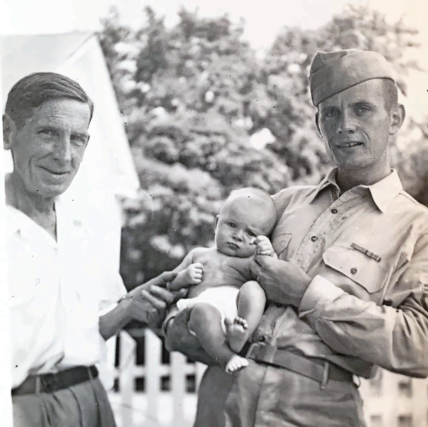 In August 1944, Conlin held his first-born child, Andrew, alongside his father-in-law.