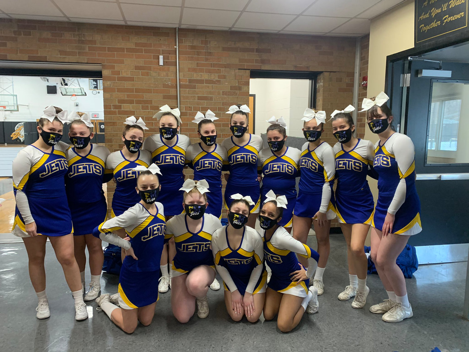 The East Meadow High School cheerleading team was back at practice as high-risk sports were given the green light to resume last month.
