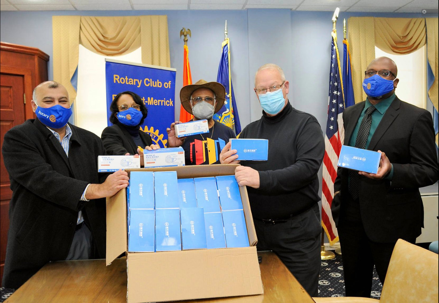 Freeport Mayor Robert Kennedy, second from the right, accepted 2,000 masks from Freeport-Merrick Rotary Club members, from the left, Ken Dookram, Florence Marc-Charles, Eddy Marc-Charles and Marc Rigueur on Feb. 12.