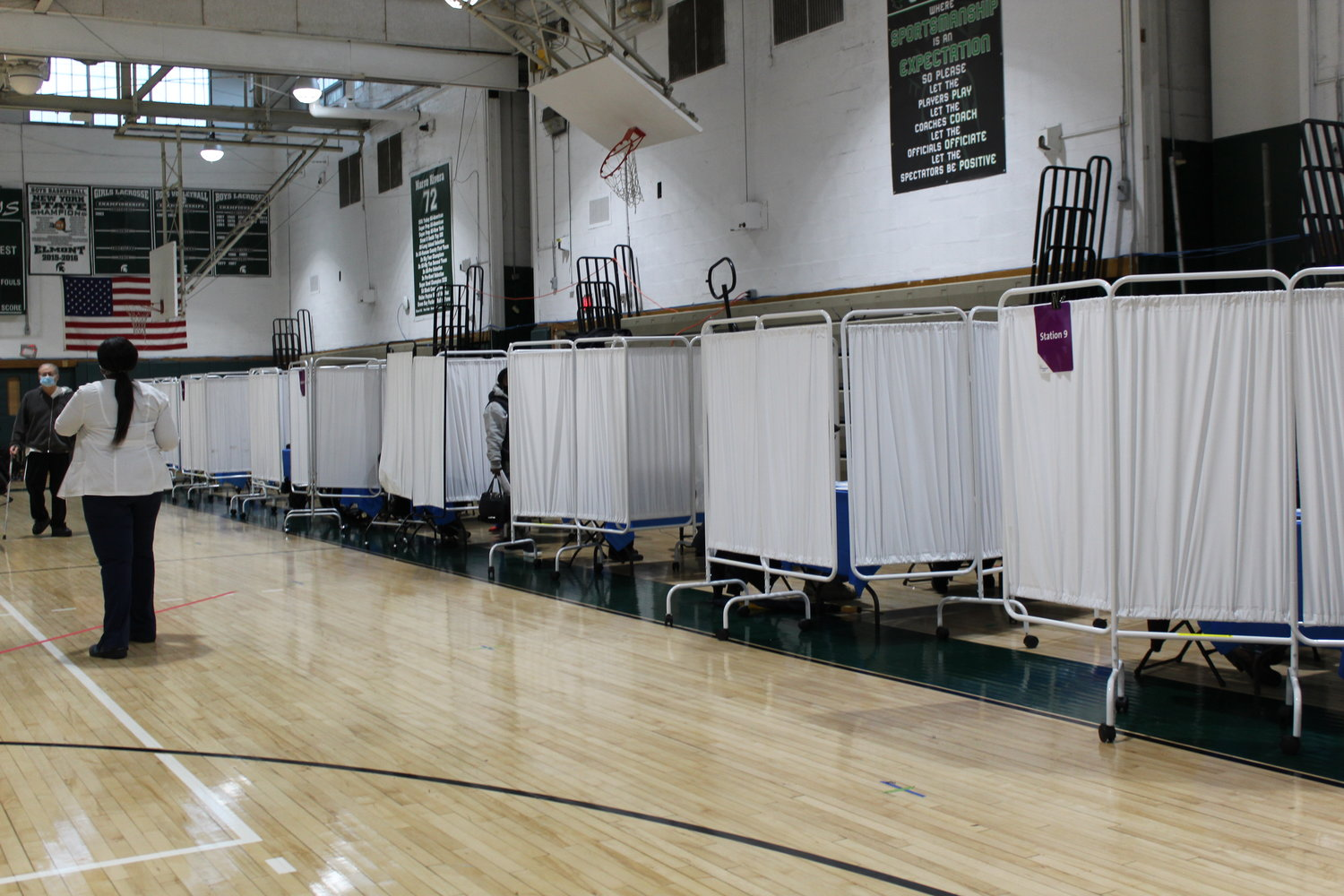 Booths were set up in the Elmont Memorial High School gym to provide 1,000 residents with Covid vaccines.