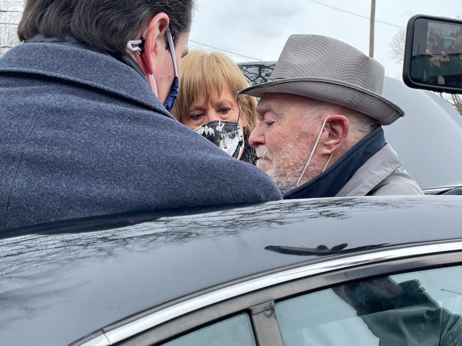 Woodmere resident and Holocaust survivor Jack Rybsztajn is helped from the car by State Sen. Todd Kaminsky and Gural JCC Associate Executive Director Cathy Byrne.