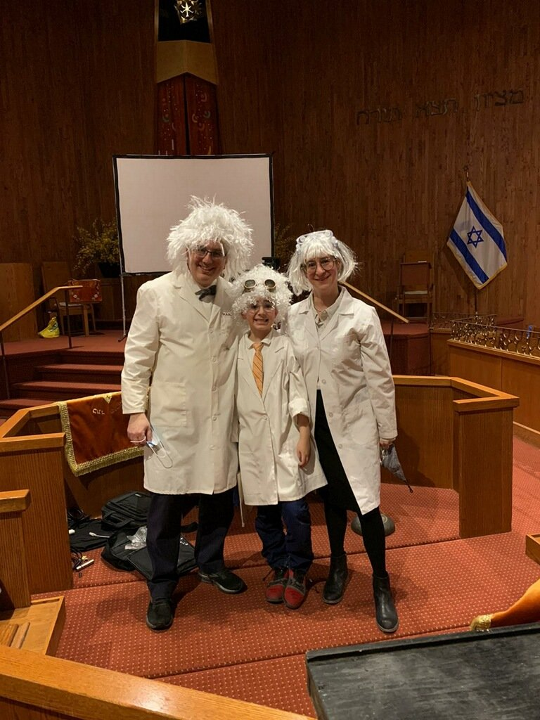 At Congregation Ohav Sholom, in Merrick, the Ebbin family — Rabbi Ira, Isaac and Chevi — went a little mad for Purim by dressing up as mad scientists.