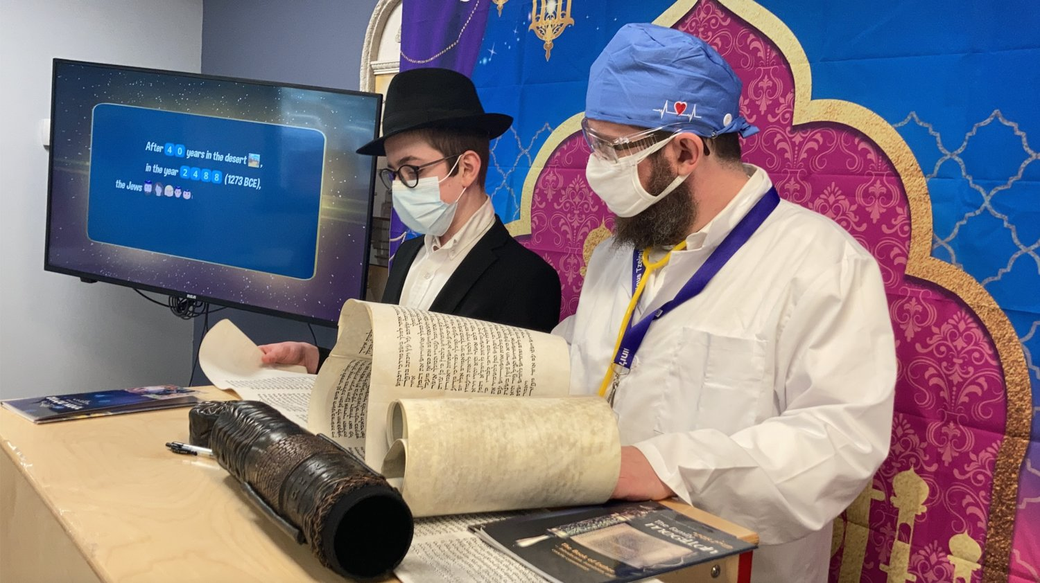 Rabbi Shimon Kramer, of the Chabad Center for Jewish Life, in Merrick, delivered an in-person Megillah reading to congregants in celebration of Purim.