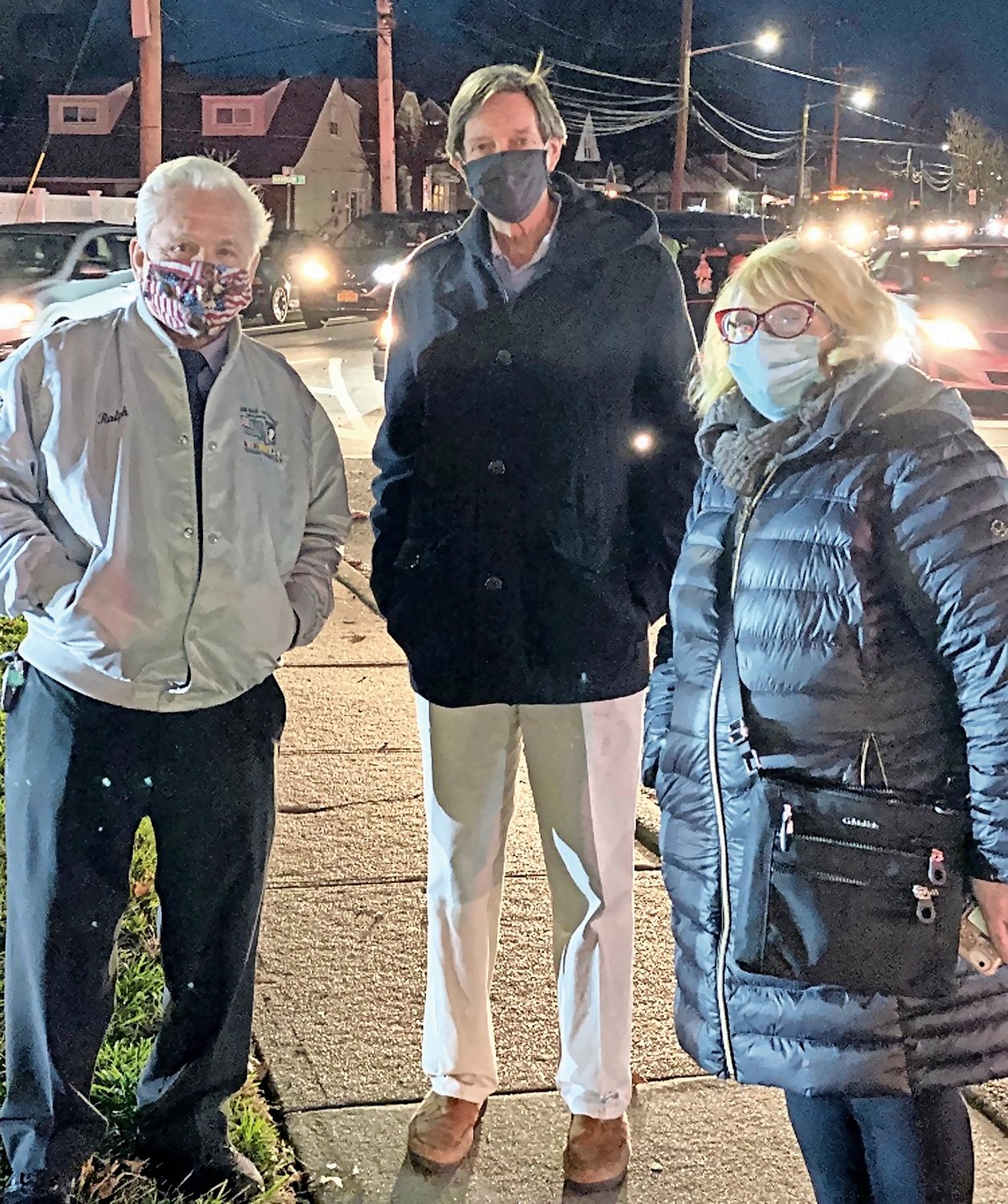 Julie Marchesella, right, has helped run the Elmont Chamber of Commerce's annual Christmas tree lighting ceremony over her 25 years as a chamber member. She was with board members Ralph Esposito and Pat Boyle at the ceremony in December.