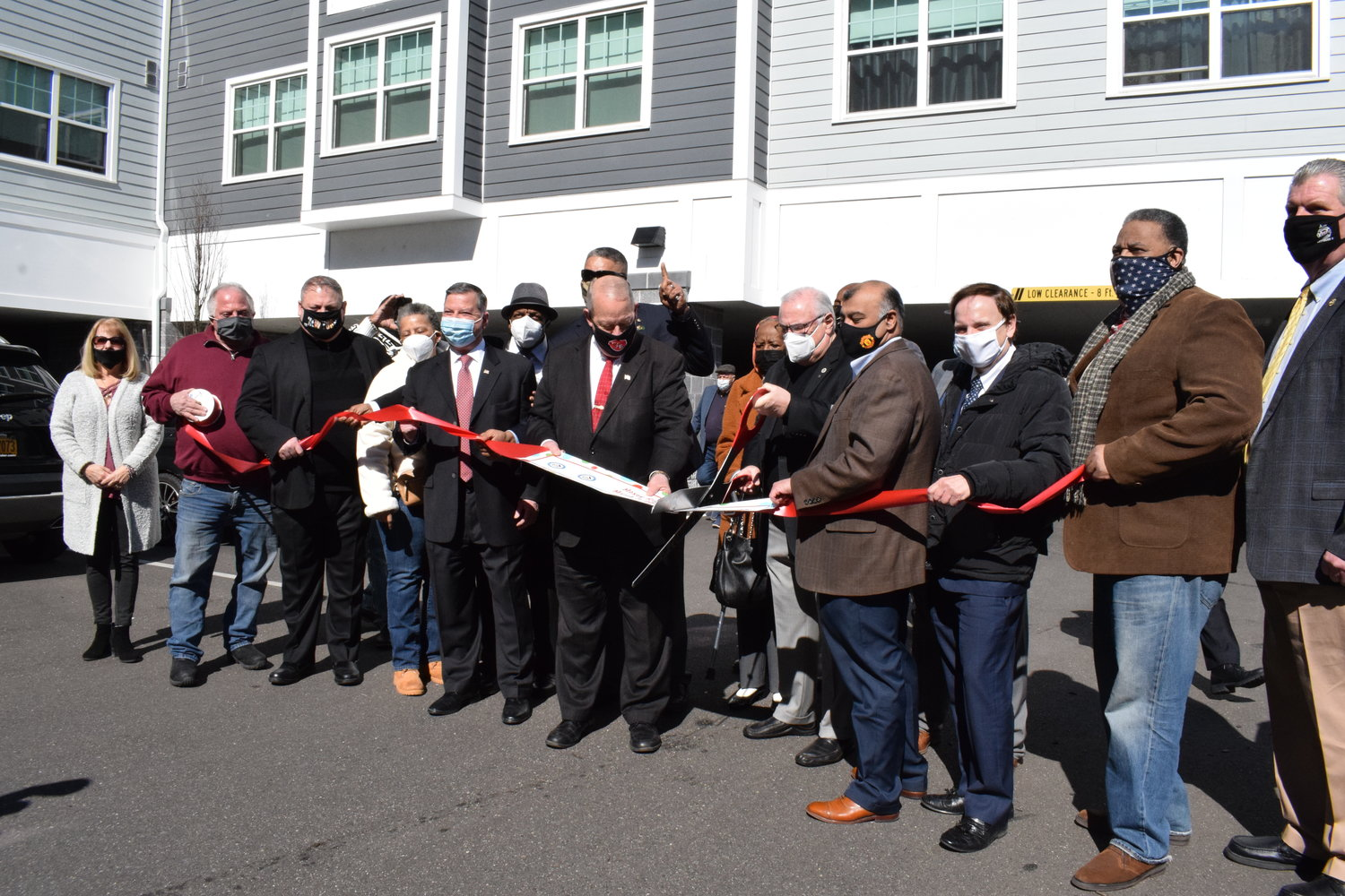 Freeport Village and Housing Authority officials, joined by the family of the late Judge Moxey Rigby, held the official ribbon cutting ceremony for the new Moxey Rigby building on March 3.