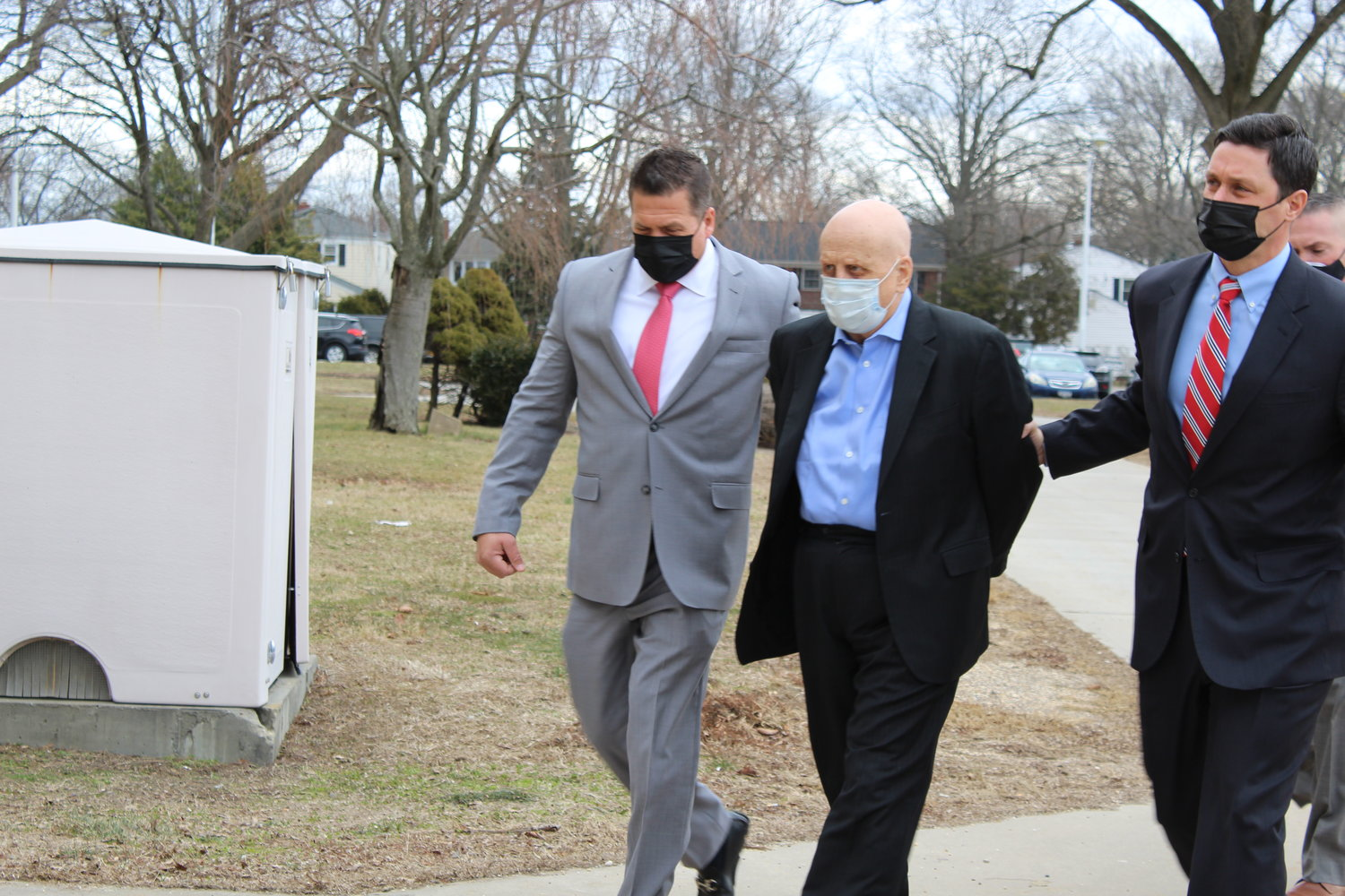 George Blatti, a former doctor from Franklin Square, was escorted into the Nassau County courthouse on Thursday.