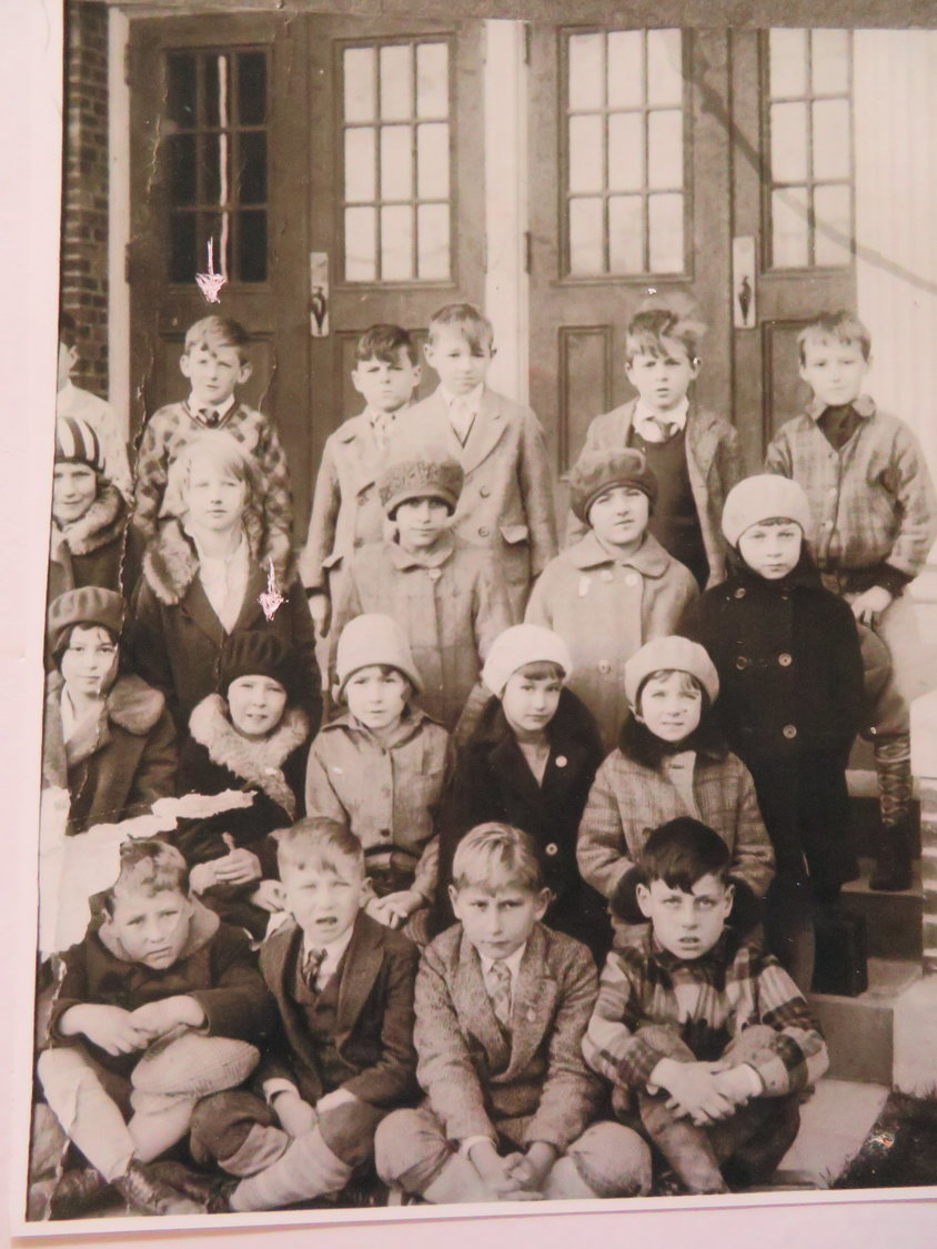Bonne and his wife, Anna Nelson, attended elementary school together at Eagle Avenue School, far right. The two are identified with arrows above their head.