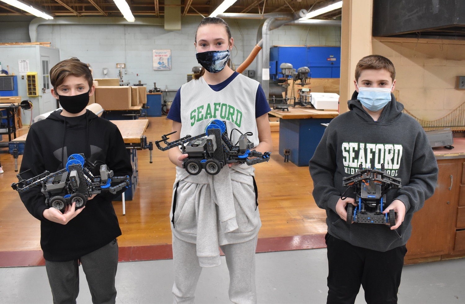 Eighth grade-students Kyle O'Hagan, left, Emily Richardson and Nick DeLeo revealed some of the robots they built in Robotics Club.