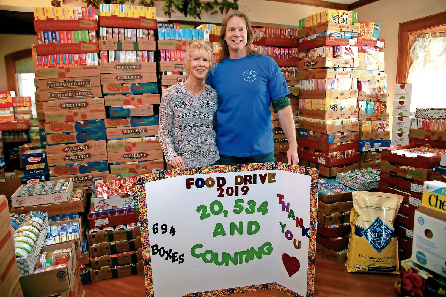 Mary and Rob Hallam, shown above in 2019, are continuing their annual food drive despite the challenges of the pandemic.