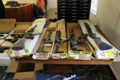 Numerous firearms were seized from the ring.