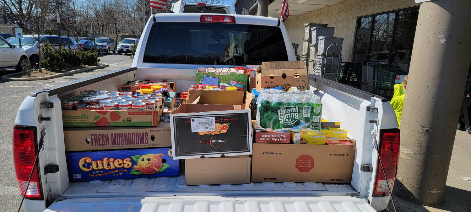 Seven truckloads of non-perishable food and 54 gift cards, were collected for local pantries with monetary donations amounting to $545.