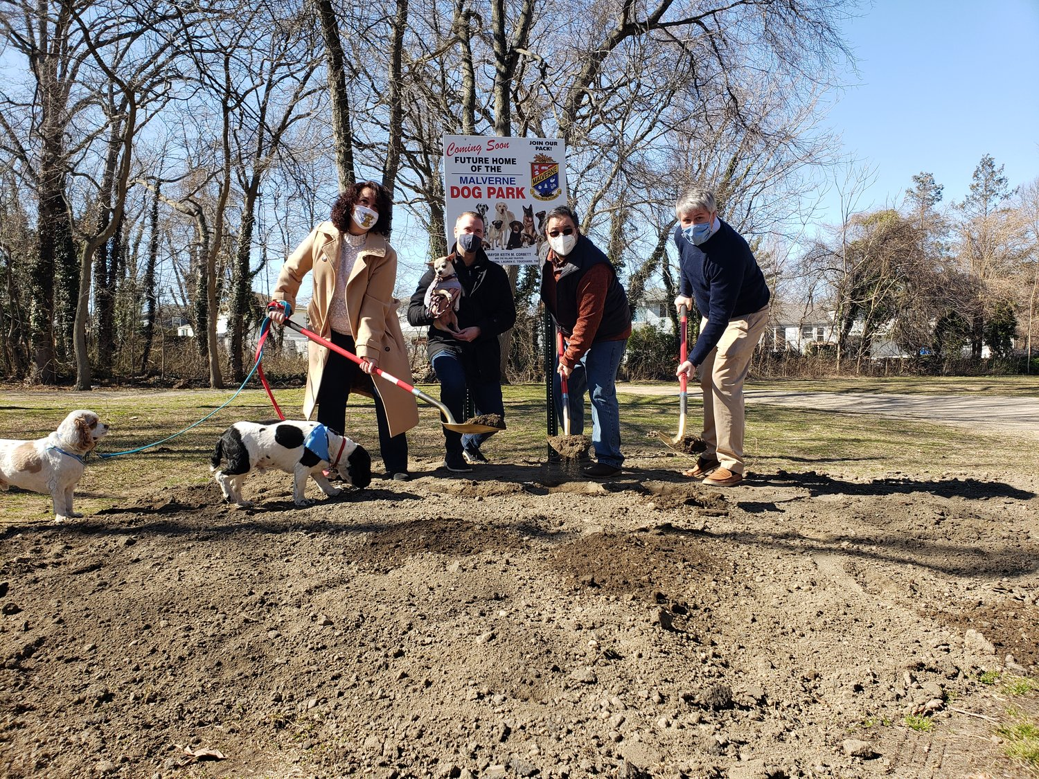Malverne Mayor Keith Corbett, right, was joined by former Deputy Mayor Patricia Canzoneri-Fitzpatrick, trustee Tim Sullivan, second from left, and Deputy Mayor Perry Cuocci as they broke ground on a dog park at Whelan Field last Saturday.