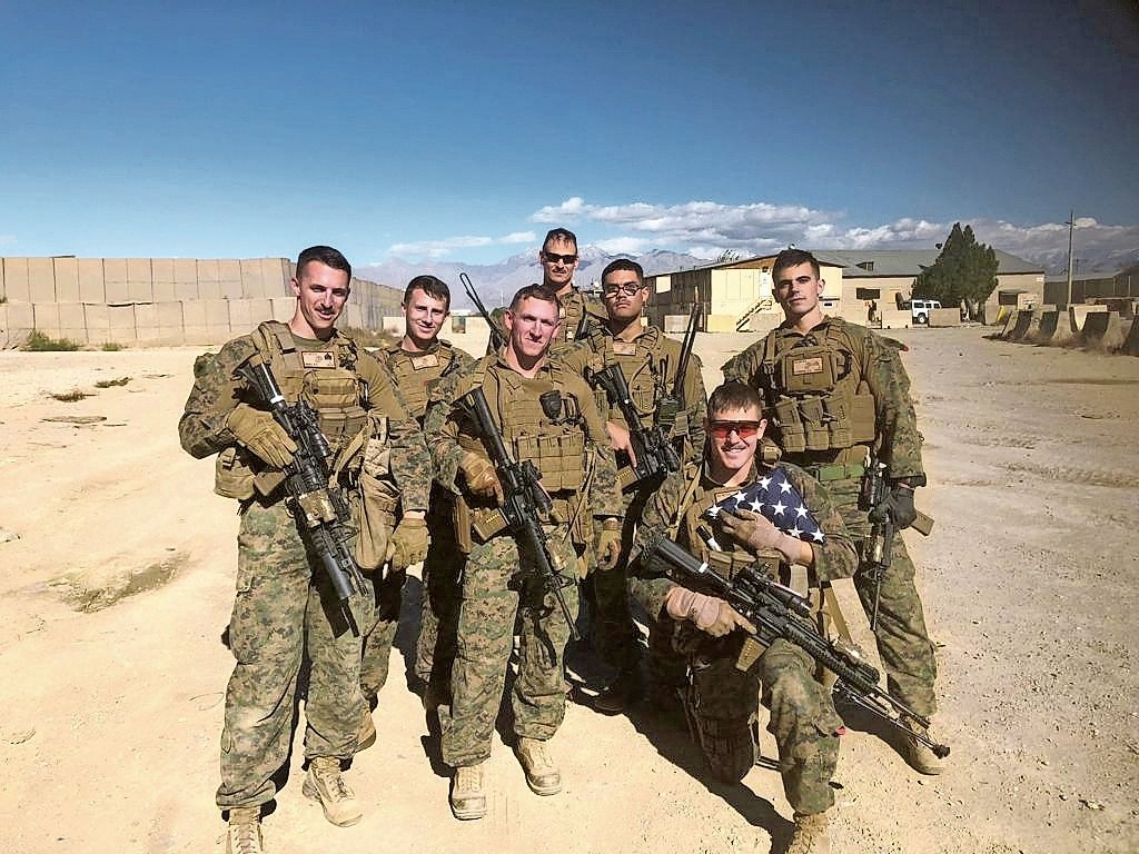 Sgt. Ben Hines, far left, Sgt. Christopher Slutman, back center, and Sgt. Robert Hendriks, far right, were killed by an improvised roadside explosive device that detonated near their vehicle in Afghanistan.