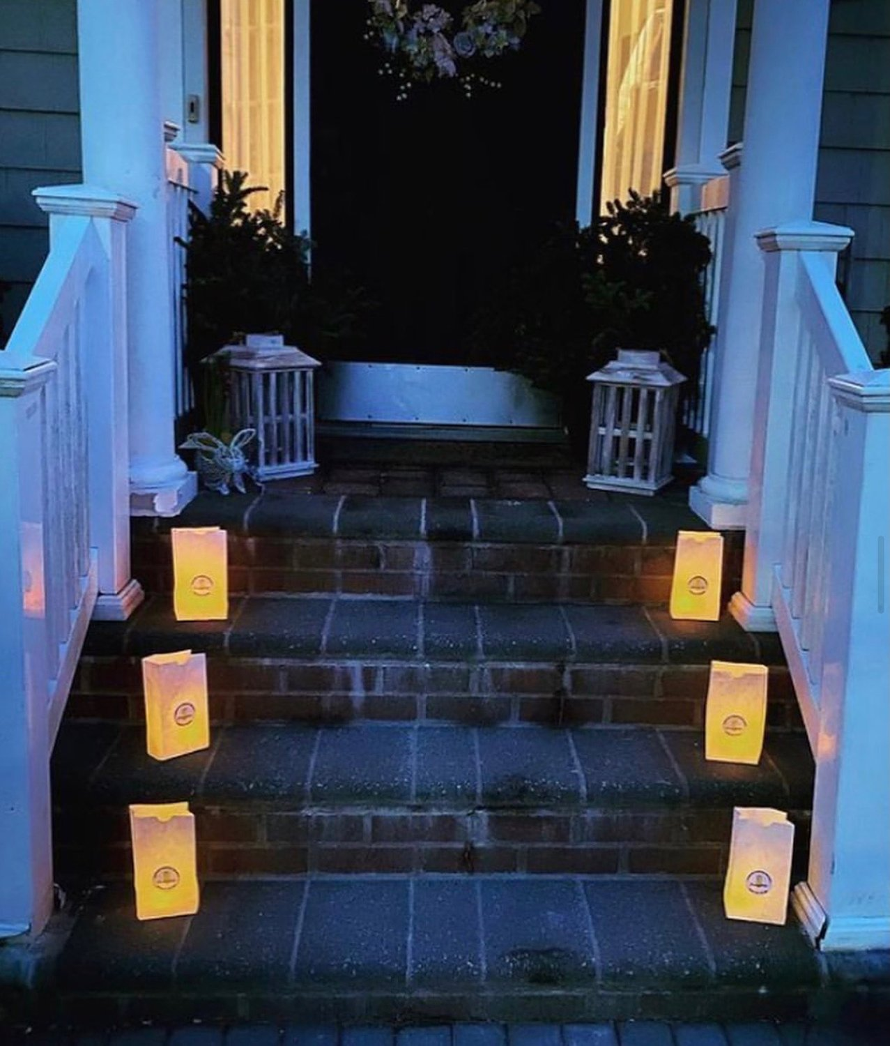 Community members placed luminary bags on their front porches in a show of support for seniors and to raise funds for them.