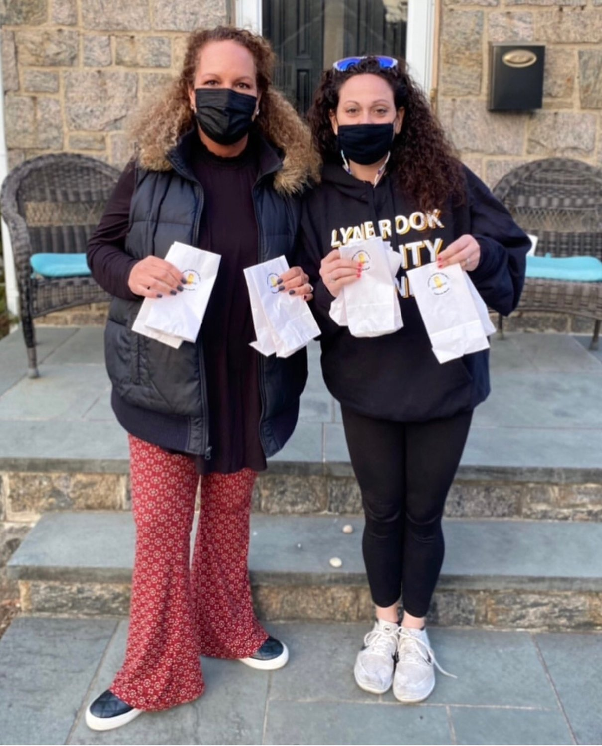 Lynbrook High School Student Government Association adviser Mary Kirby, left, and Waverly Park Student Council adviser Shari Bowes teamed up to ensure the fundraiser was a success.