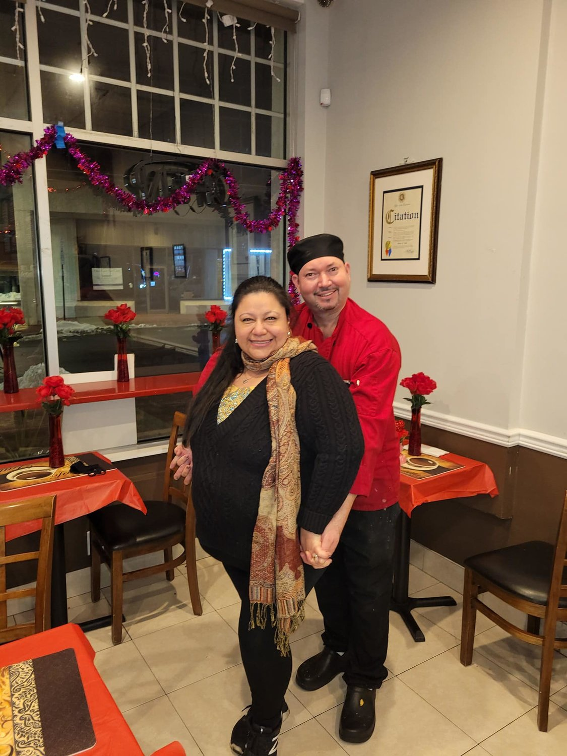 Elsa and Moris Valle decorated Chef Moris Cafe for diners on Valentine's Day. They are looking forward to seeing more customers with the new guidelines.