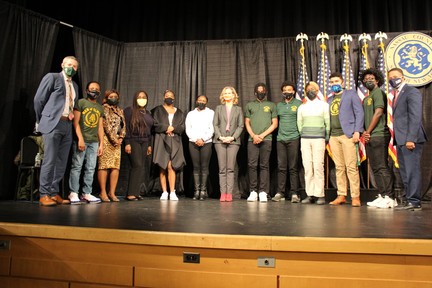 Curran, center, took a photo with the Elmont Leading Ladies and the Men of Elmont, who discussed police reform with county officials. They were with Elmont Memorial High School Principal Kevin Dougherty, left.