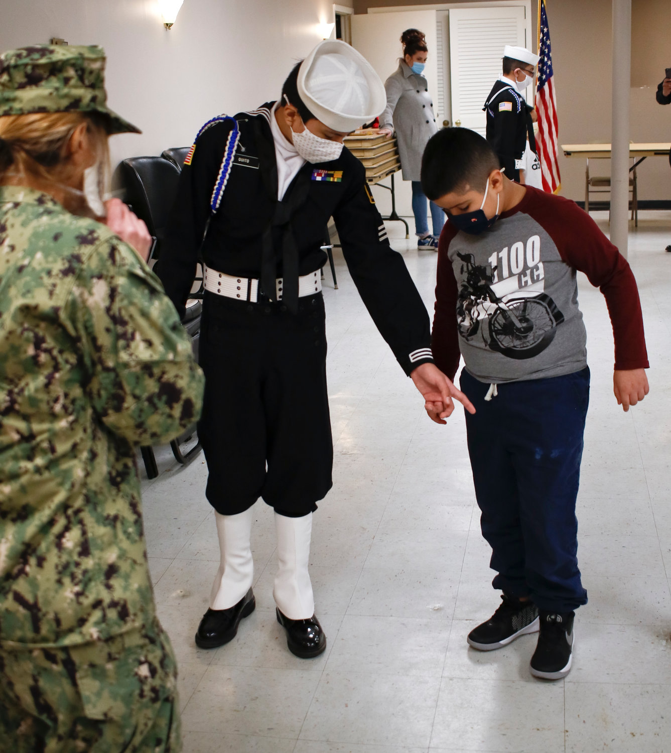 Newest member Joshua Pereira, who attended his first meeting Saturday learned how to do an about-face turn from Jairo QUito and Lt. Cmdr. Samuel.