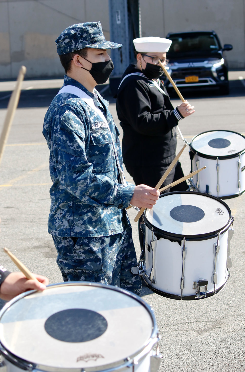 Sebastian Encalada and Allison Bepnate helped perform band drills with the corps.