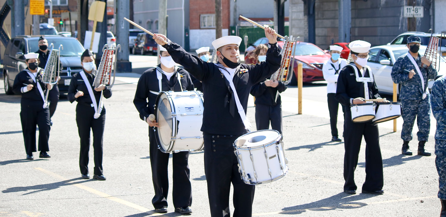 Acting Band Manager Juan Pimentao, of the New York Naval Cadet Corps, directed the band during drills in Valley Stream on Saturday, when the Valley Stream American Legion invited the group to its hall for practice.