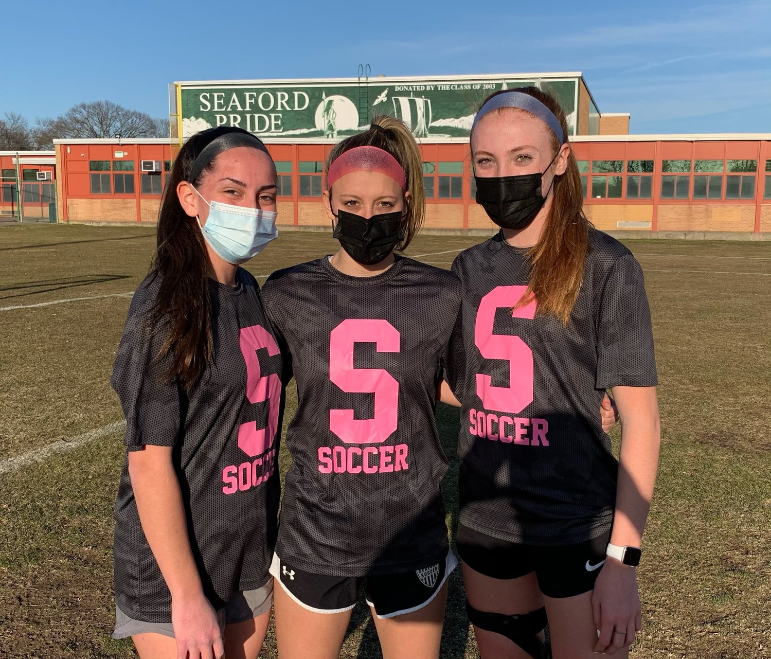 From left, seniors Ashley Sidoti, Niki Kassimatis, and Olivia Pearse serve as Seaford's captains.