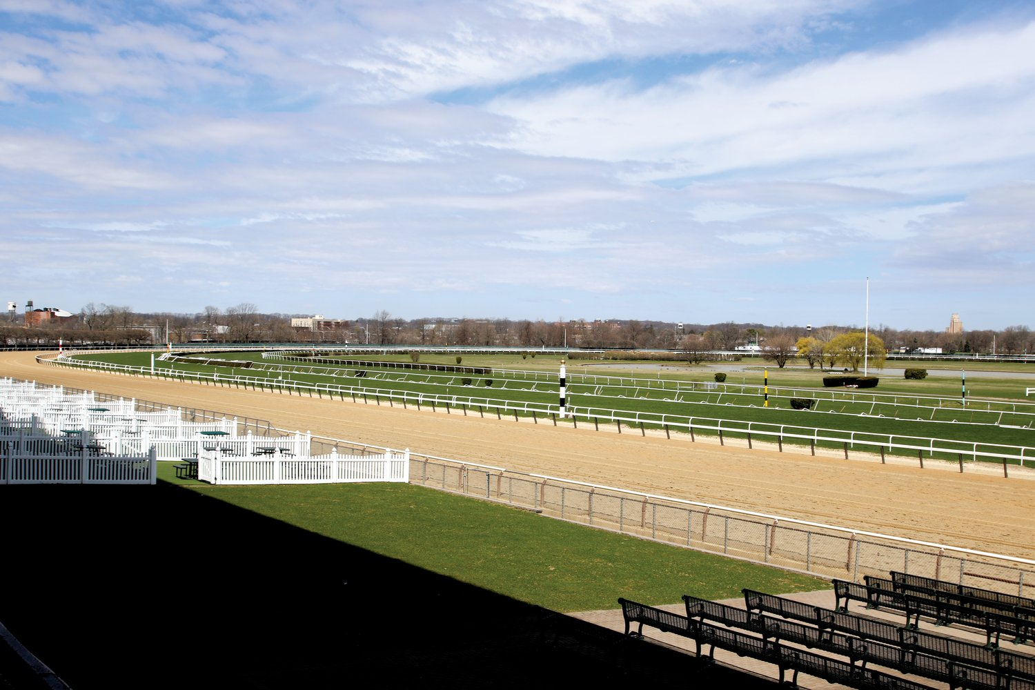 New York Racing Association officials are considering winterizing the track at Belmont Park, and reducing the size of the grandstand so that it no longer casts a shadow over the track.