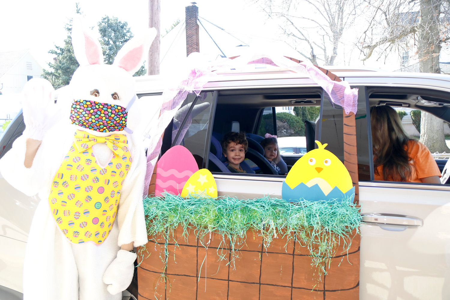 Oceanside Kiwanis and DOCA partnered on the Bunny Brigade event, a drive-by parade in celebration of Easter. The Costigans, Kane, 4, and Reese, 2, met the Easter Bunny, who was masked up for safety, outside School No. 6.