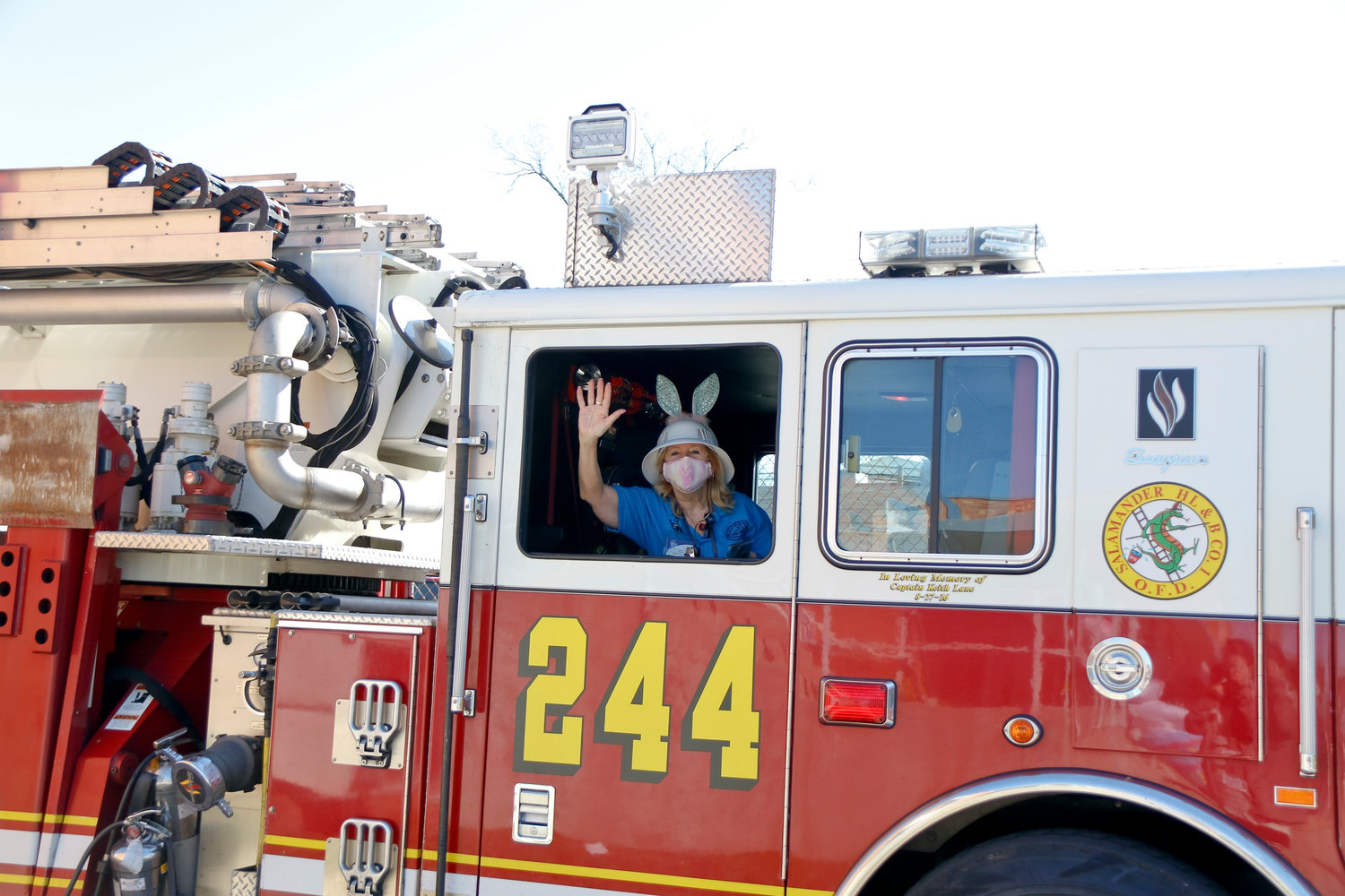 DOCA Youth Coordinator Nancy Baxter, at left, led the Bunny Brigade in a fire truck.
