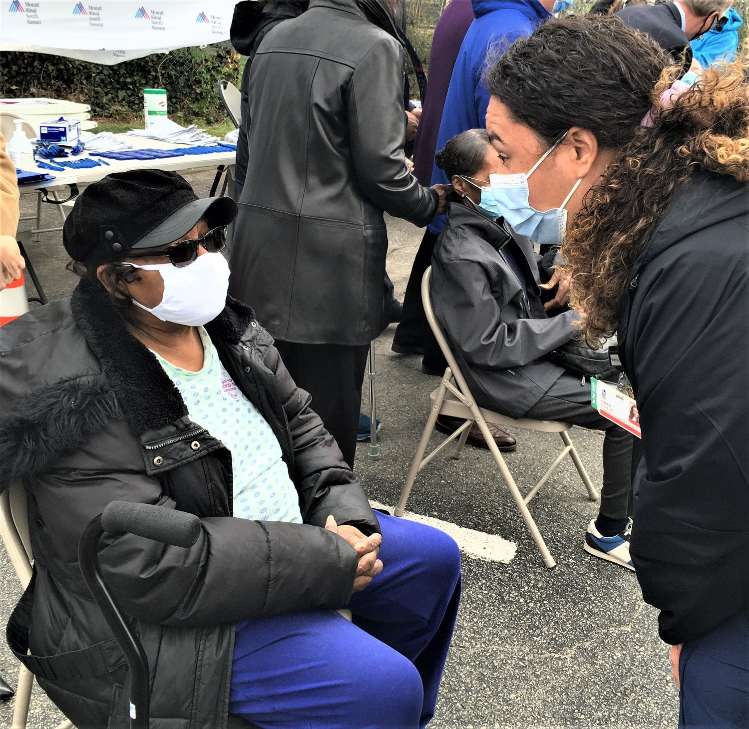 After her vaccination, Elizabeth Haggood, of Uniondale, received instructions from Amber Vitale, director of the Pandemic Department at Mount Sinai South Nassau.