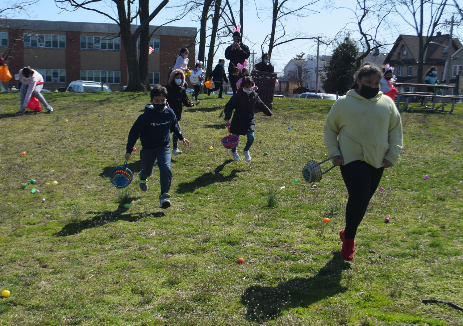 The 9- to-12-year-olds raced down the recreation field hill to collect their eggs on Saturday at the 'Egggggstravaganza.'