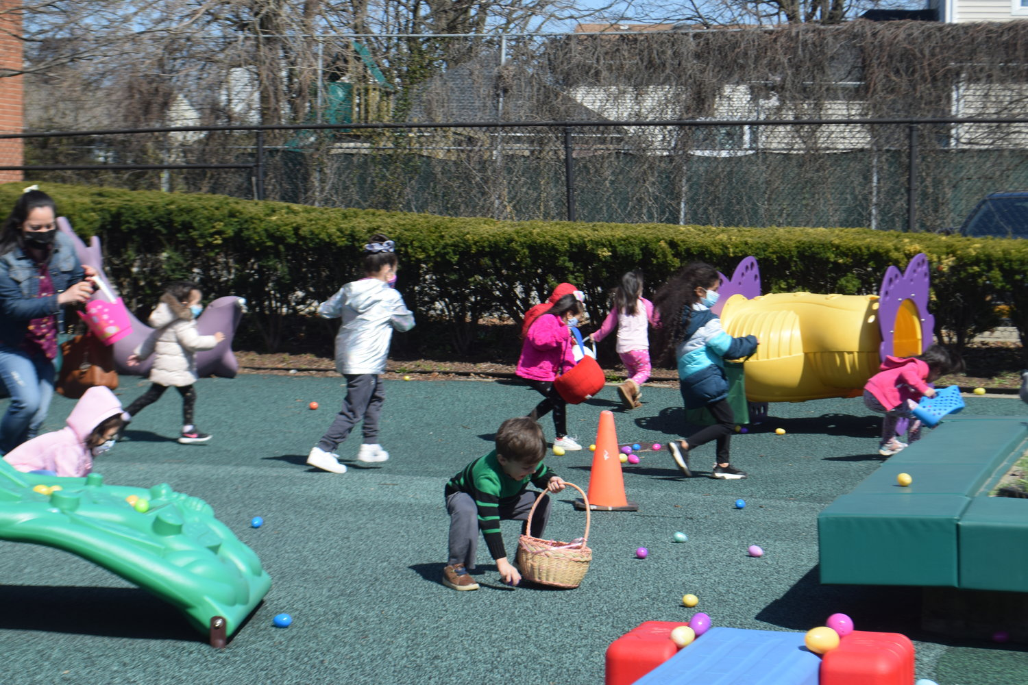 The Community Center playground was the site for the 2- to-4-year-olds mad dash for eggs.