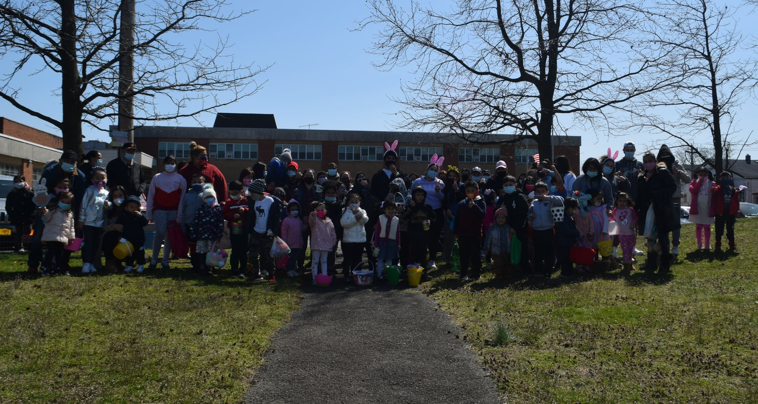 Adults, children and volunteers after the first egg hunt of the 'Egggggstravaganza' on April 3.