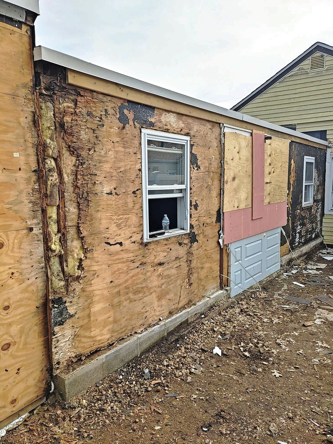 All of the exterior sheathing of the Helfenbein family home in Hempstead was rotted.