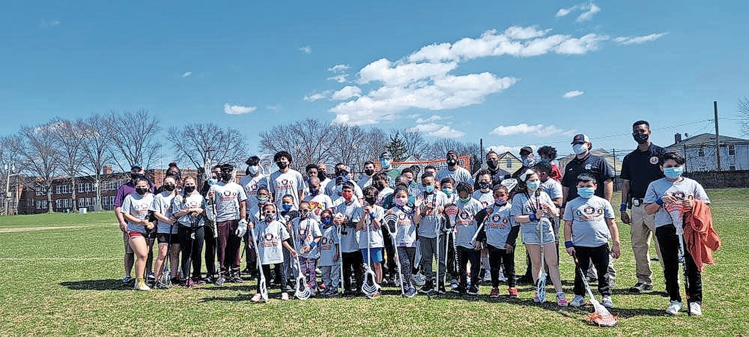 More than 30 elementary-age children participated in the Elmont PAL's one-day lacrosse program, taught by Elmont and Sewanhaka players.