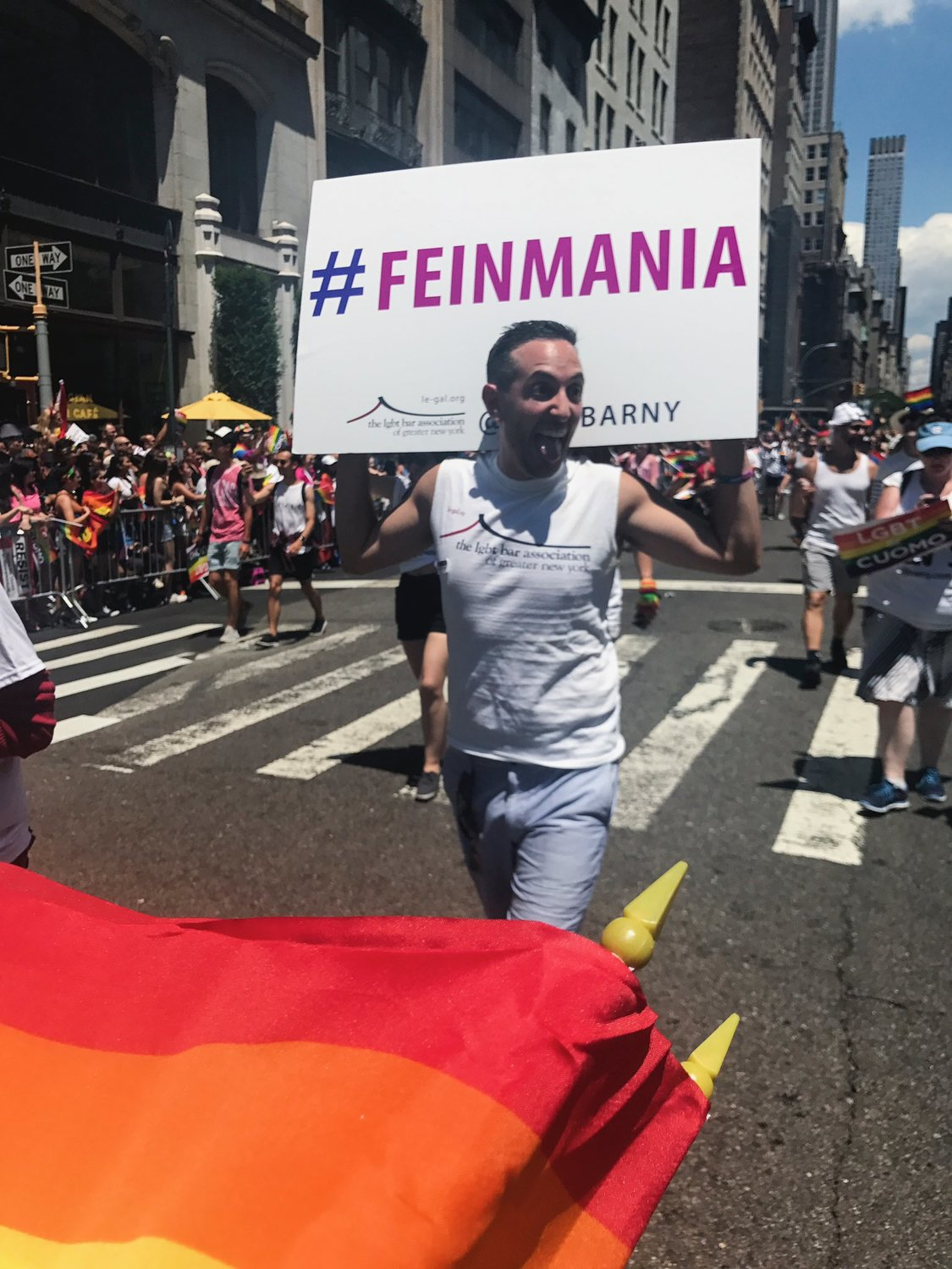 "After Feinman's confirmation to the state's highest court, members of the LGBT Bar  Association of New York joined the NYC Pride Parade with shirts and signs that read ""Feinmania."""