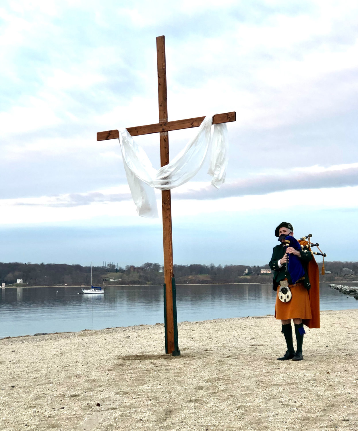 "Bagpiper Robert Lynch played ""Amazing Grace"" at the start of the service on Sunday."
