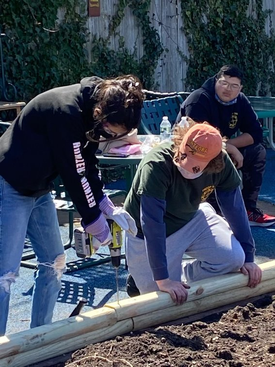 Volunteers Emily Adamo, David DeRienzo and Scott Molina were hard at work in the garden at Temple B'nai Torah.
