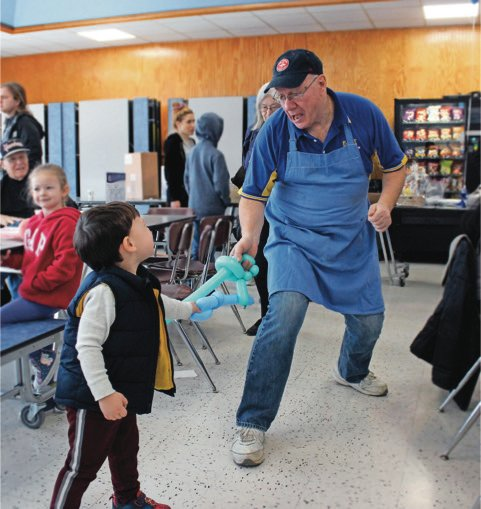 Brian Stieglitz, who was the East Meadow Herald editor in 2020 and is now the editor of the Wantagh and Seaford Heralds, received a first-place honor for Feature Photo for this endearing image of 3-year-old Ropper Thompson having a blast with cook Steve LaSala at an East Meadow Kiwanis Club breakfast in March 2020.