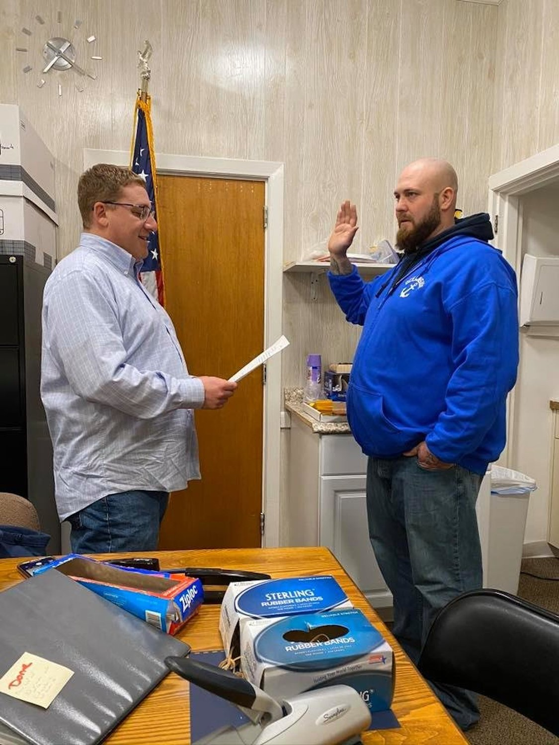 Oceanside Sanitation District No. 7 Commissioner Ryan Hemsley, right, being sworn in by Chairman Austin Graff, said he would not resign after controversial Facebook posts he was alleged to have made surfaced.