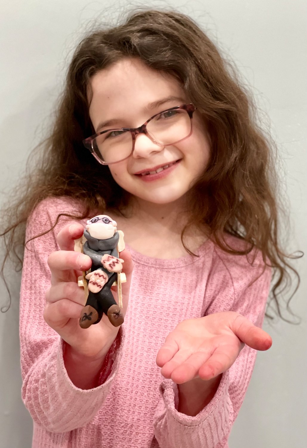 Julianna Tand, 9, of Merrick, held her sculpture of Vermont U.S. Sen. Bernie Sanders, which helped her raise more than $3,000 for the Ronald McDonald House Charities New York Metro.
