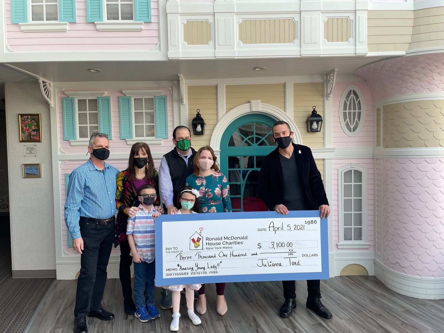 Julianna's grandparents, Joe and Debbie Viola, far left, joined the 