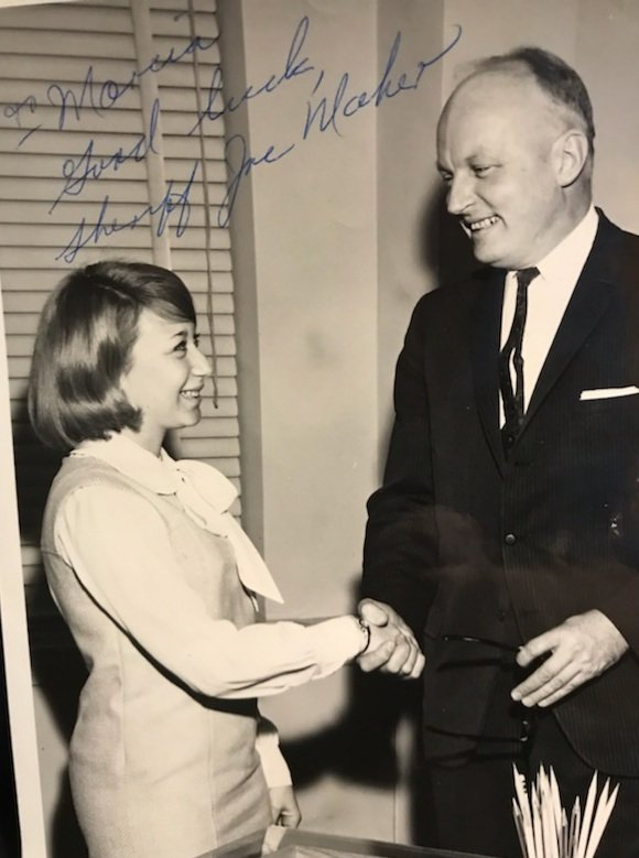 Then Nassau County Sheriff Joseph Maher congratulated Gould, then 23, on becoming the first civil service employee in his office in March 1966.