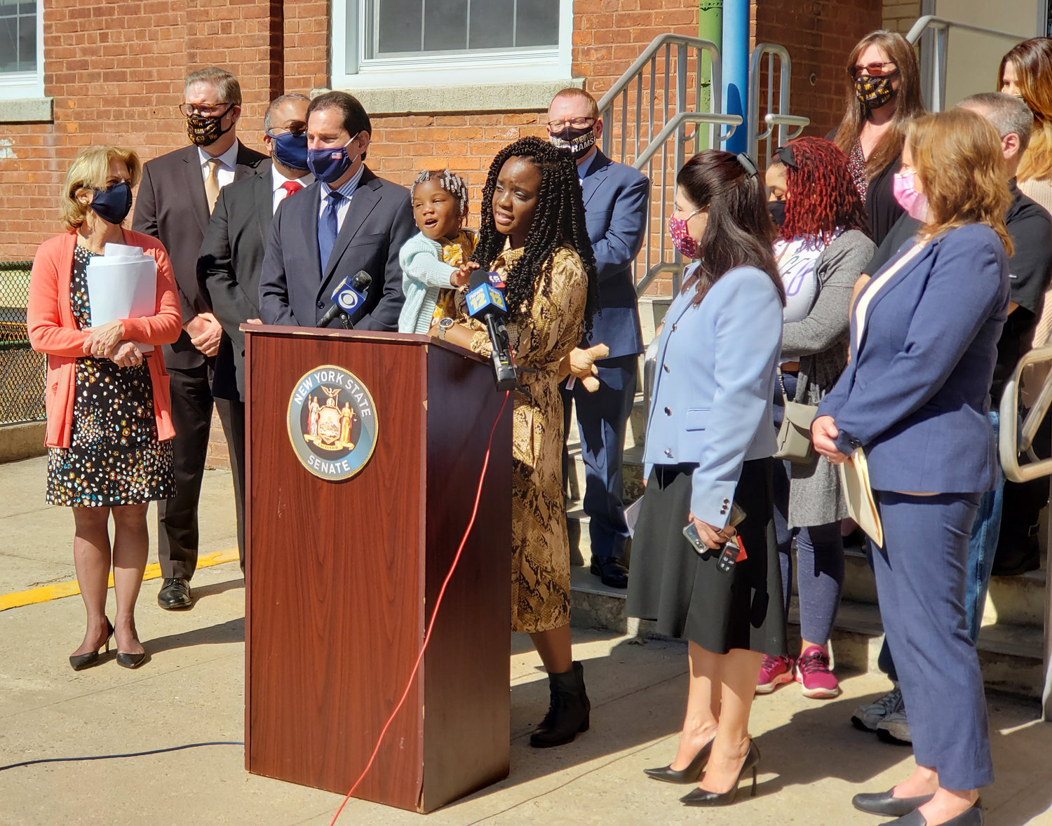 West Hempstead parent Oroma Mpi-Reynolds, at lectern, was excited for her 4-year-old daughter, Riley, to be a part of Chestnut Street School's pre-K program.