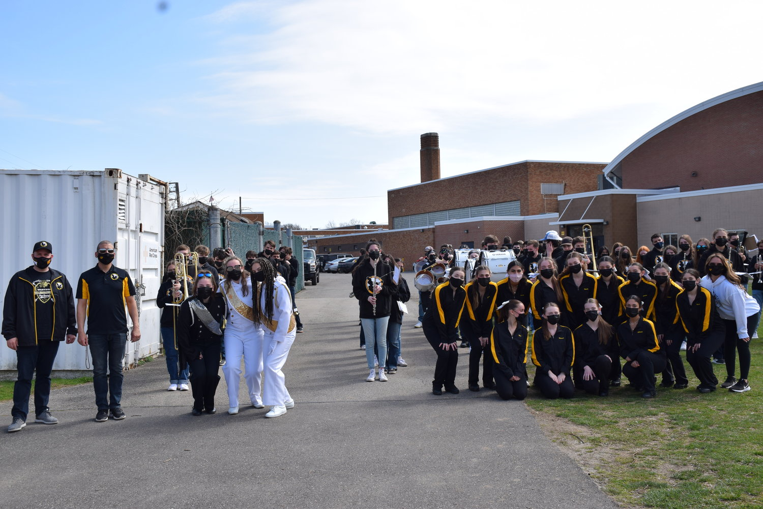 The Wantagh High School marching band and dance team posed for a quick photo prior to the halftime performance.