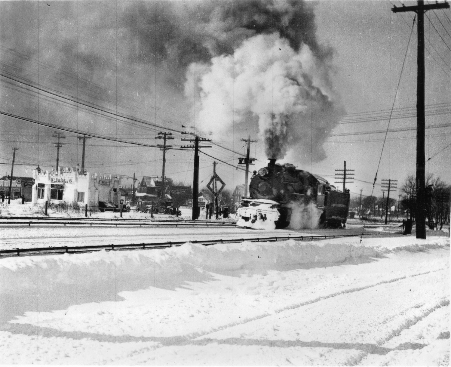 A Long Island Rail Road steam train crossed Broadway near White Castle in the 1930s.
