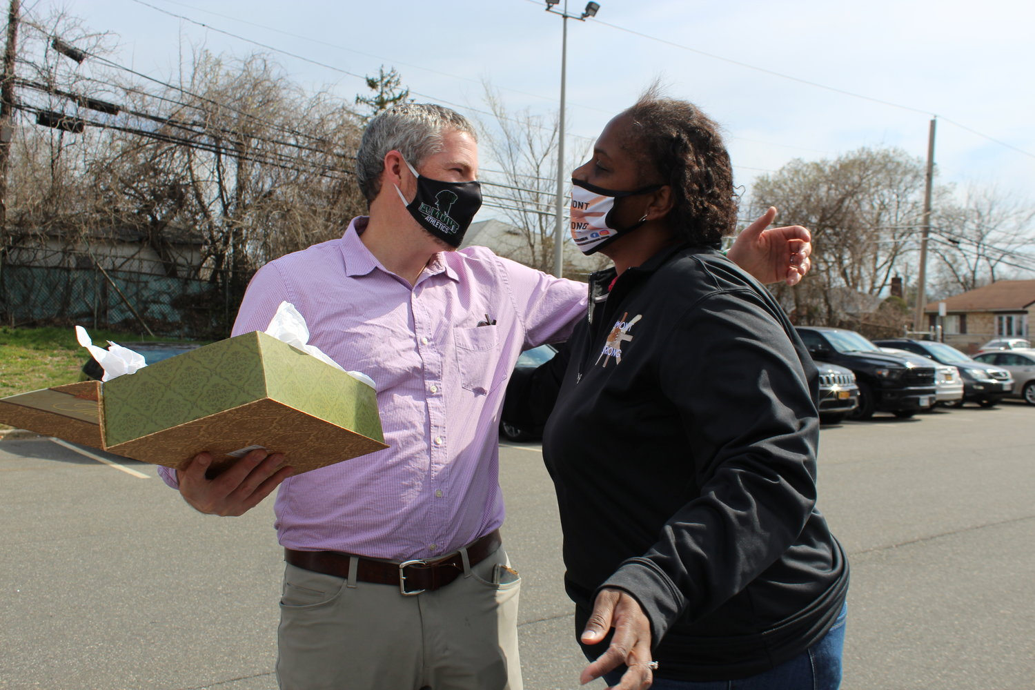 Rachelle Lewis, co-founder of Elmont Strong, gave Dougherty a box of thank-you letters.