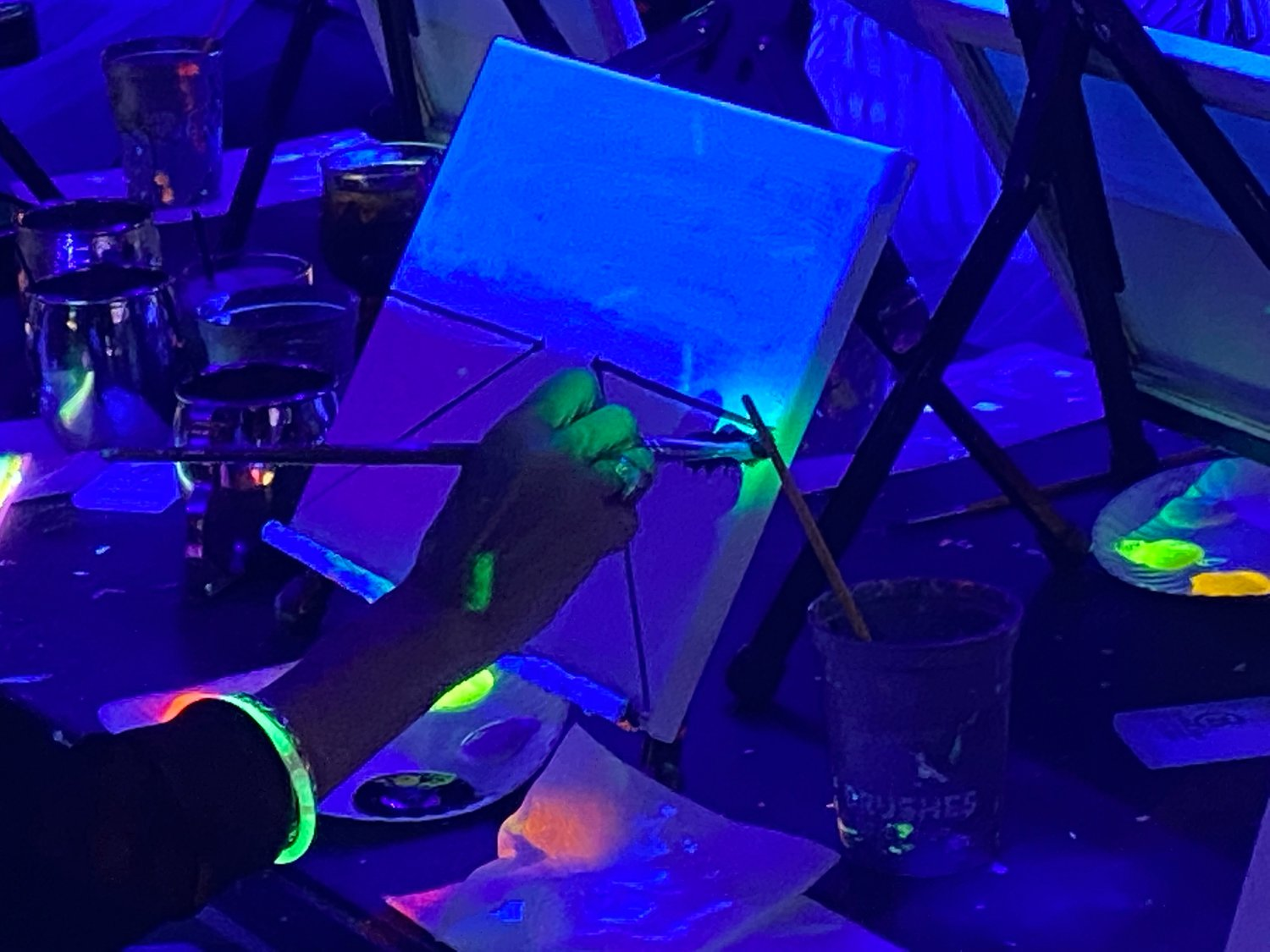 Under the black light, the colors popped as event attendees followed the step-by-step instructions.