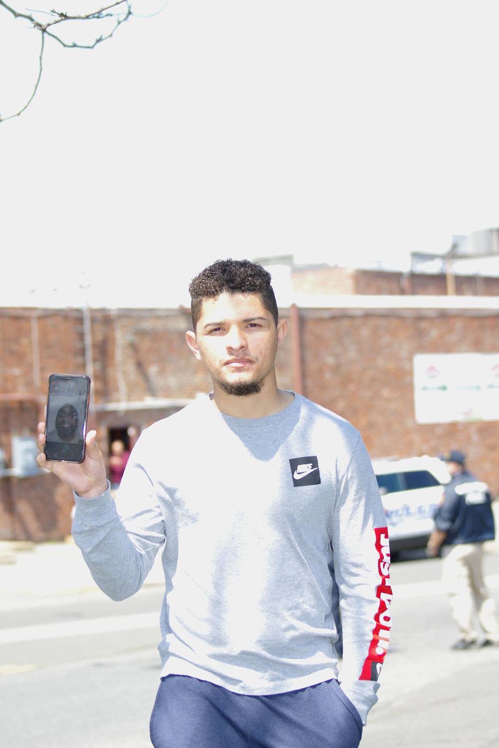 Frank Martinez, of West Hempstead, held a cell phone with images of the shooter, who was an employee at Stop & Shop.